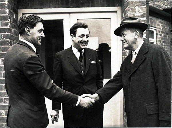 One of the first moves outside the United States was to the UK where Robert Cobb snr (right) is pictured being greeted by Peter Beck (left) and John Knowles, who set up the Cobb Breeding Company and began developing international business in the 1960s.