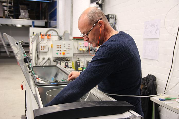 Sneak peek into Petersime's factory: wiring an Operational Excellence Technology™ controller